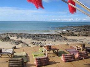 Deck overlooking the beach at Baan Phu Lae bar